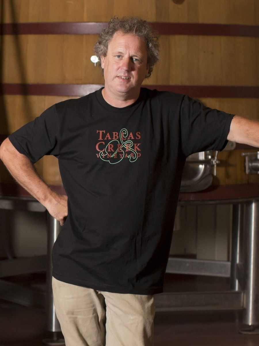 Neil Collins - Executive Winemaker and Vineyard Manager - Tablas Creek VineyardNeil was born and raised in Bristol, England. Trained as a chef, he moved into winemaking with stints with John Munch at Adelaida Cellars and Ken Volk at Wild Horse. At Adelaida, Neil met Robert Haas and the Perrins of Château de Beaucastel when they were just beginning the search for Tablas Creek. Neil was so intrigued by the project that he offered his services, and spent a year working and learning at Château de Beaucastel.Before the year was finished, Neil was offered the winemaker position at Tablas Creek, and he has overseen both the organic vineyard and the winery since 1998.His philosophy is that great wines can only come from great grapes, and that the art of winemaking is founded on starting out with the very best grapes and bringing their juice through fermentation as naturally as possible.Neil was named San Luis Obispo County Winemaker of the Year in 2013.