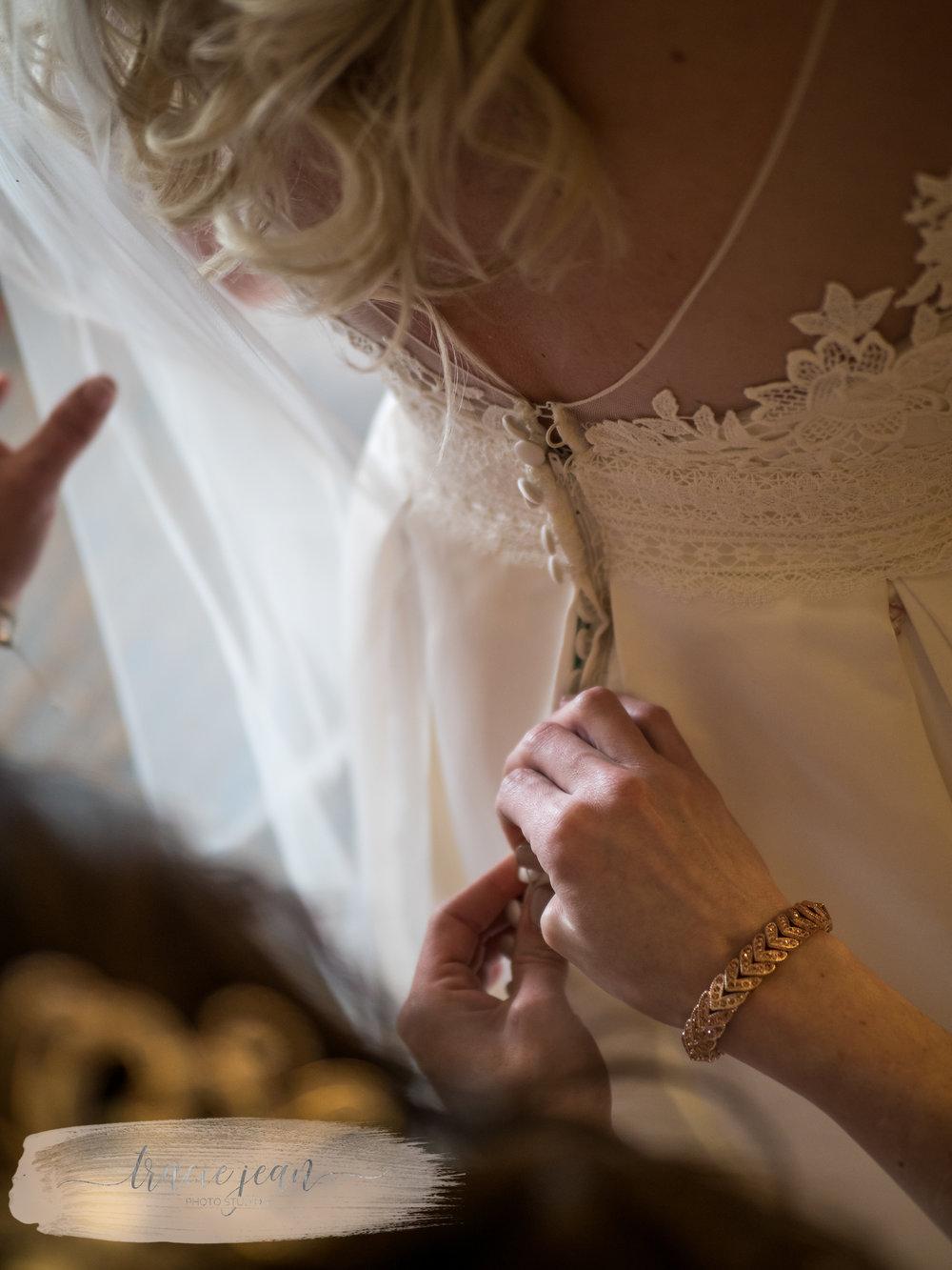 Fastening the Brides Gown