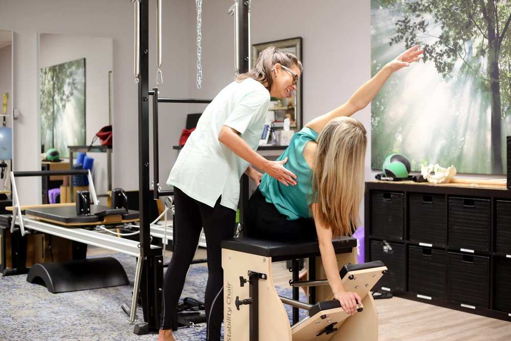 Lisa, our pilates guru, treating a patient at Sarton Physical Therapy Tustin.