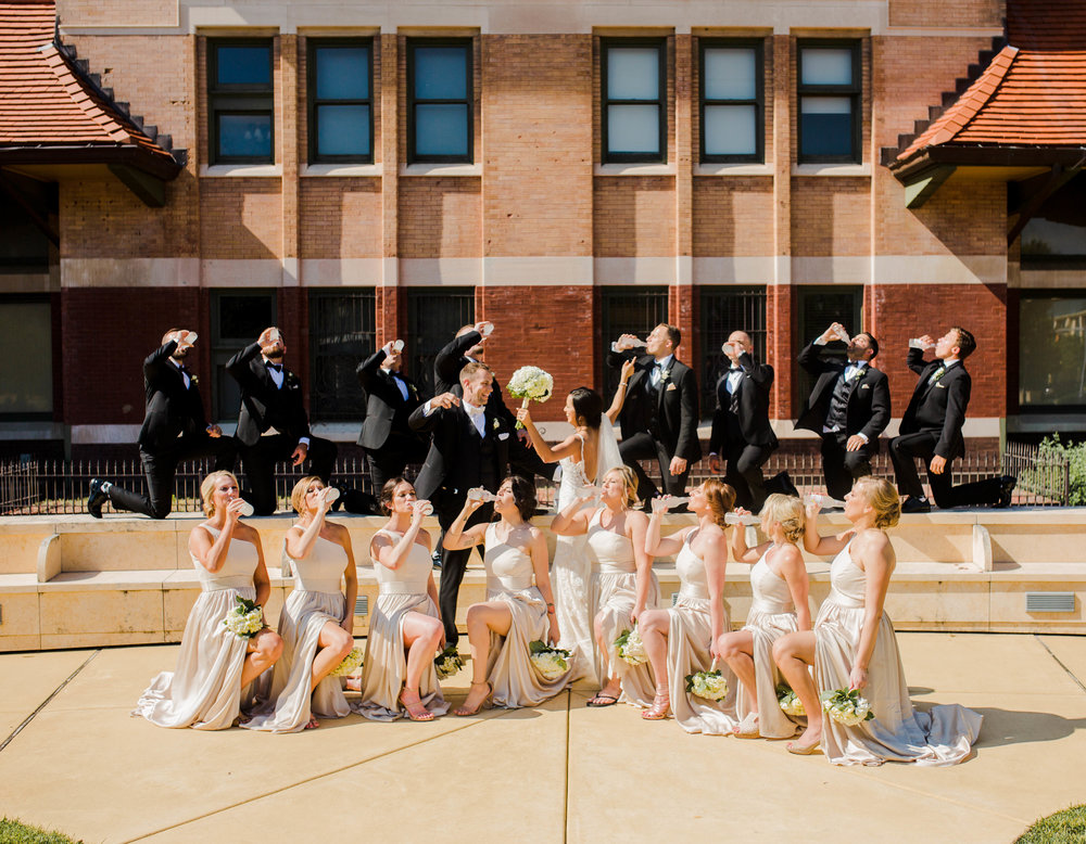 "The Bride & Groom were big on ""icing"" people and successfully pulled off icing the bridal party during photos!"