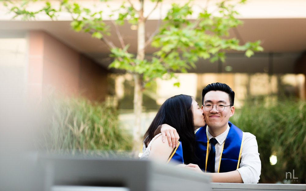 los angeles ucla senior graduation portrait cute couple kissing at ucla engineering building