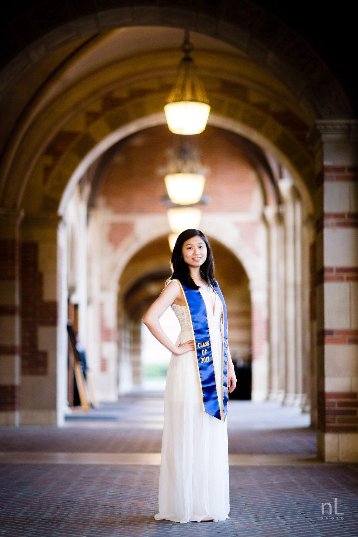 los angeles ucla senior graduation portrait girl in white dress under royce hall archways