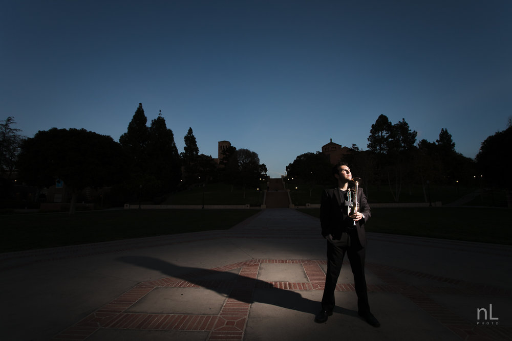 los-angeles-musician-epic-dramatic-environmental-portraits-trumpet-player-in-suit-at-dusk-blue-hour