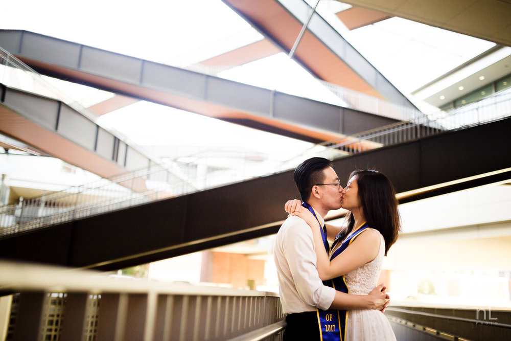 los angeles ucla senior graduation portrait of cute couple kissing under beautiful architecture