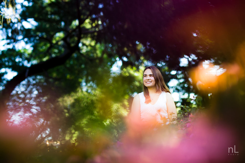 los angeles ucla senior graduation portrait bright beautiful sunrise girl in field of pink flowers