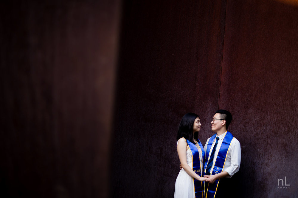 los angeles ucla senior graduation portrait cute couple holding hands in david serra sculpture broad arts center