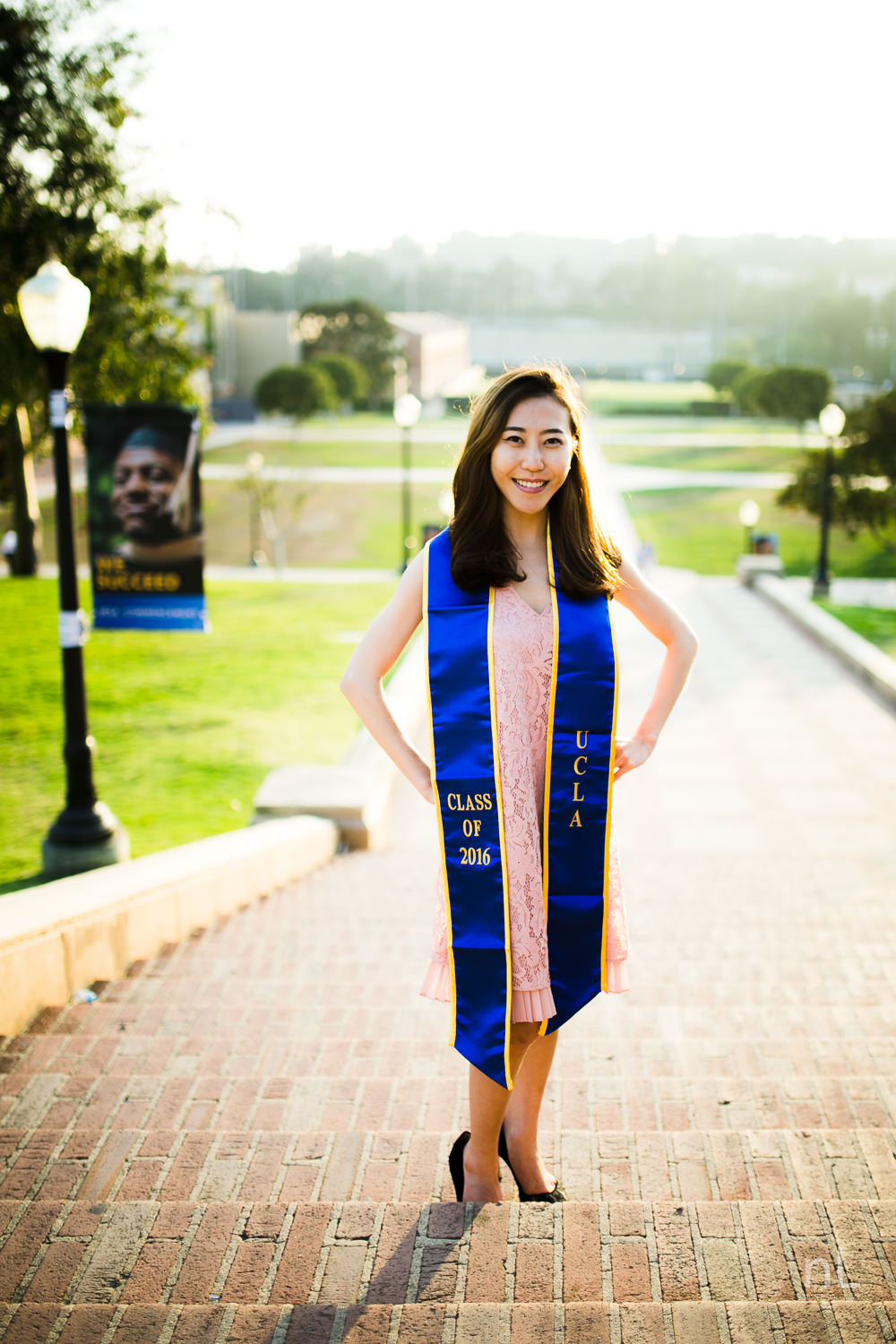 los angeles ucla senior graduation portrait asian girl with pink dress at janss steps sunset