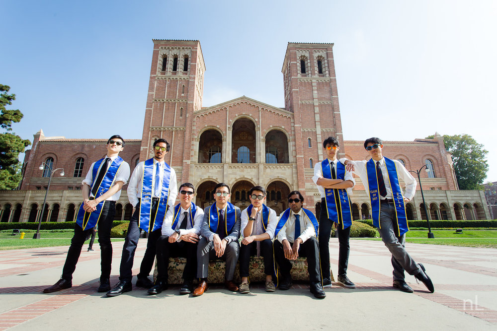 los angeles ucla senior graduation epic dramatic portrait of guys sitting on couch in front of royce hall