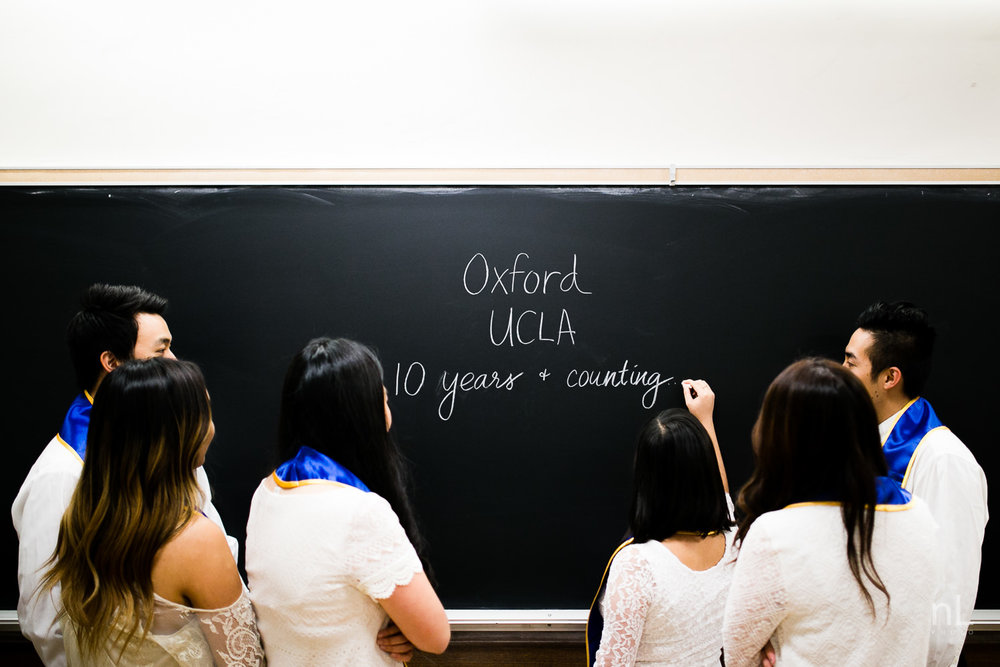 los angeles ucla senior graduation portrait best friends royce hall classroom drawing on blackboard