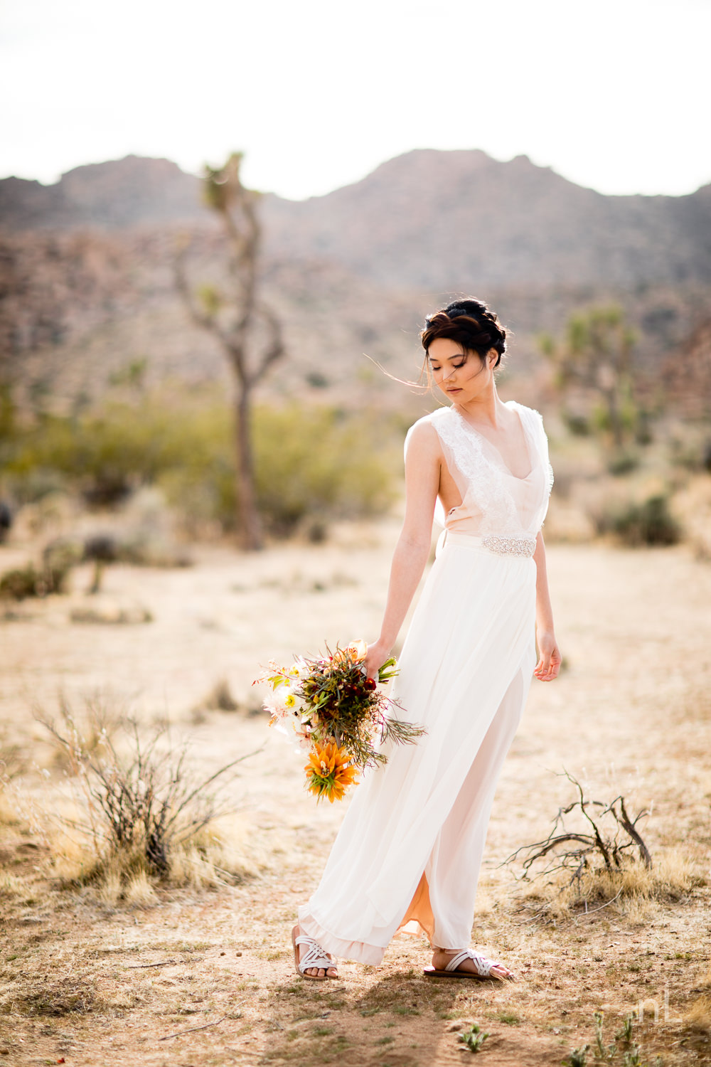 joshua-tree-engagement-wedding-elopement-photography-stylized-photoshoot-bridal-portrait-with-bouquet-and-dress