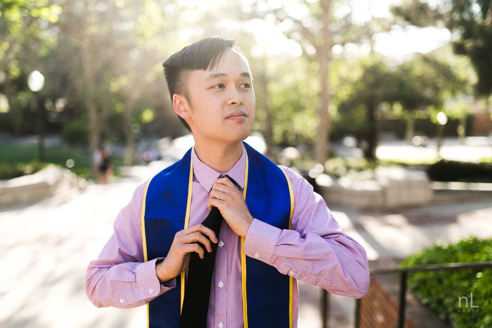 los-angeles-ucla-senior-graduation-portraits-bruinwalk-sash-fixing-tie