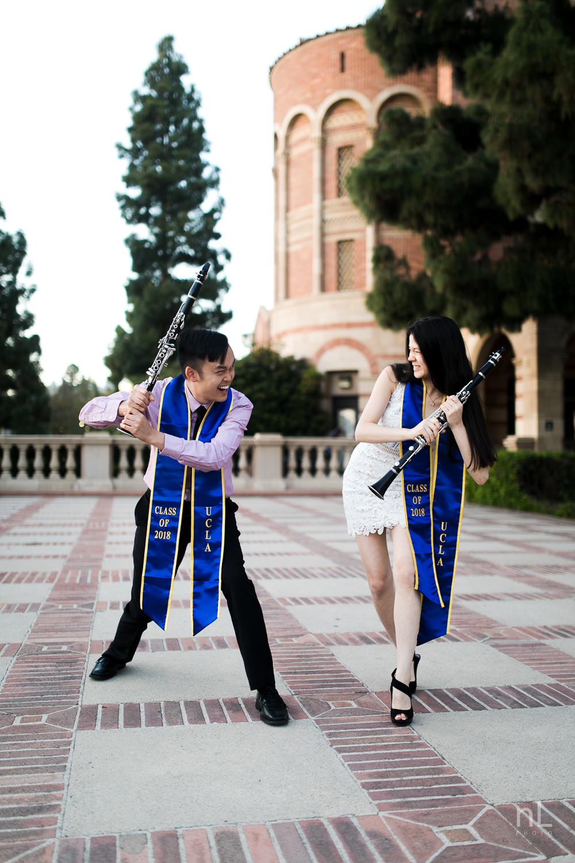 los-angeles-ucla-senior-graduation-portraits-clarinet-couple-goofing-sashes