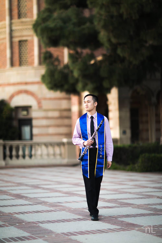 los-angeles-ucla-senior-graduation-portraits-clarinetist-sash-walking-at-sunset
