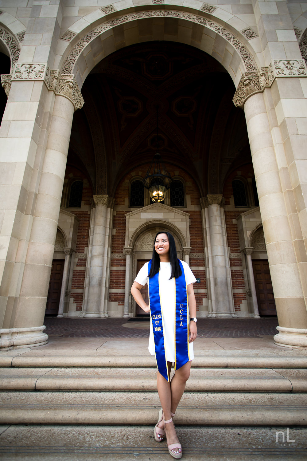 los angeles ucla senior graduation epic environmental portraits royce hall arches girl white dress sash