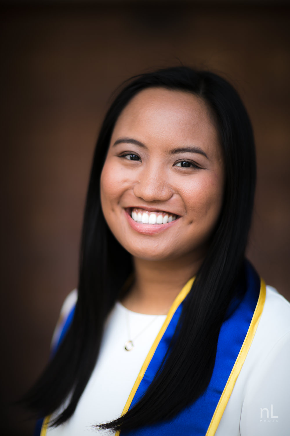 los angeles ucla senior graduation portraits royce hall front door girl white dress sash