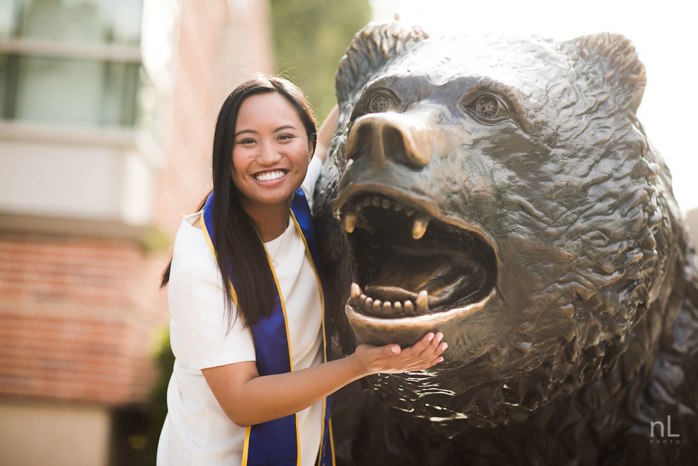 A portrait of a graduation senior at the Bruin Bear.