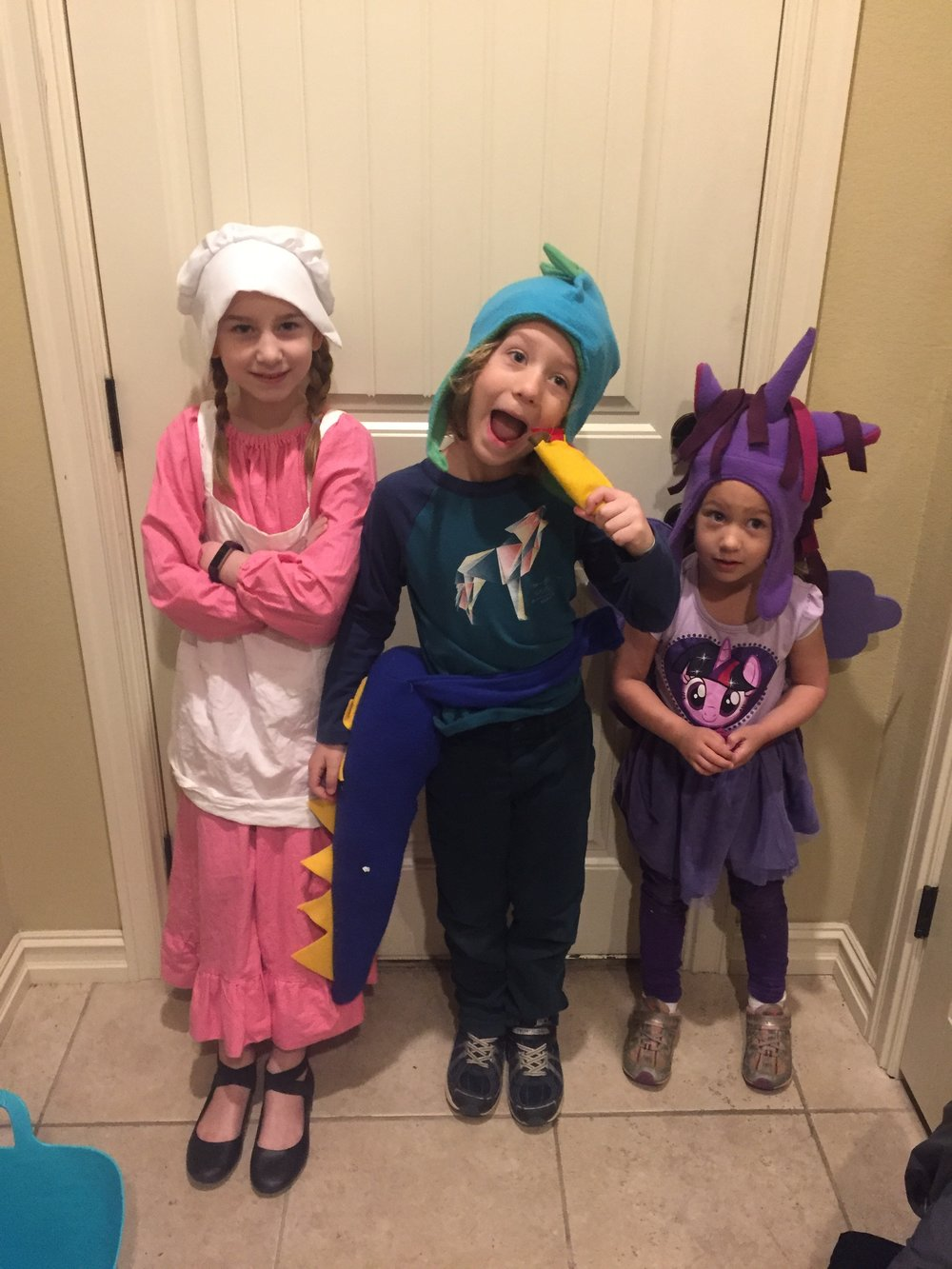 Dress like your favorite character from a book!  Laura Ingalls Wilder, Princess Twilight Sparkle, and a Dragon who LOVES Tacos!!!!! =) Donovan and I sewed up that taco very quickly to make that costume and it was SO cute!  I can't believe he's had that dino costume since his second Halloween when he was 1 year old!