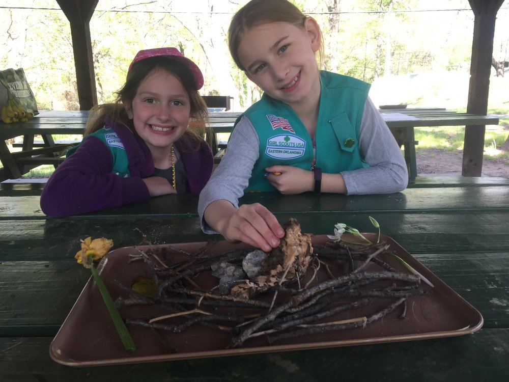 Our first Girl Scout campout! Serenity and her friend Kenzie were proud of this centerpiece they made! They collected twigs, bark and rock and made a bird in a nest! So cute!
