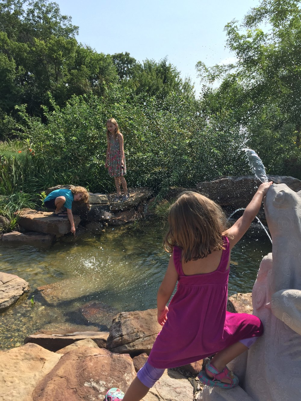 We had some unusually cool days in August so we visited the botanical garden!  Donovan and Serenity spent nearly an hour painting with water on the water wall, and making up their own imaginary worlds.  Maia and I went through the sensory garden and loved it =)