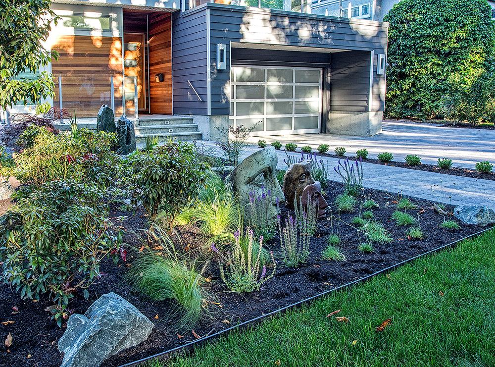 Faces of Mother Nature-statues-water garden-MustangLandscape-Victoria-BC-garden-driveway.jpg