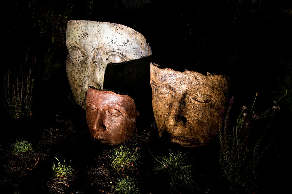 Faces of Mother Nature-statues-water garden-MustangLandscape-Victoria-BC-garden-night.jpg