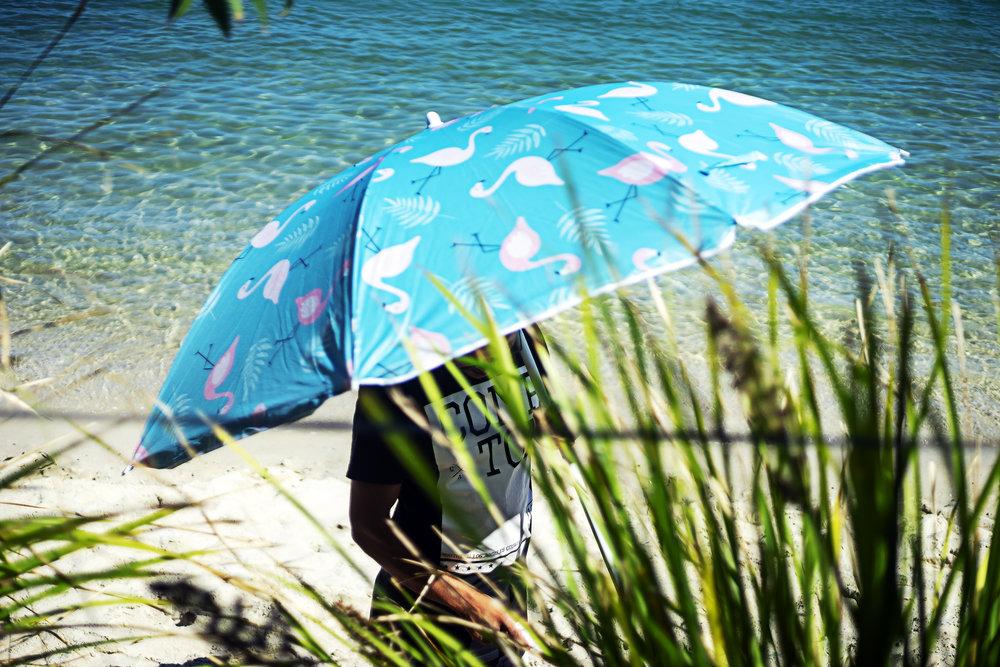 004_didi-s_gilson_australian_street_photography_candid_umbrella_nelsonbay_water_sand_shore_grasses_portstephens_2018.jpg