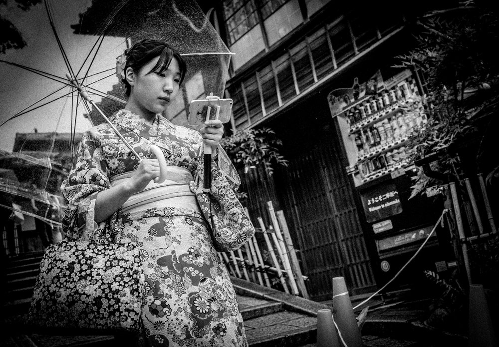 Girl with a Selfie Stick, Kyoto 2017 from the series  Tokyo is Yours  ©Meg Hewitt