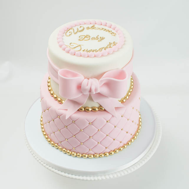 Pink and gold quilted baby shower cake