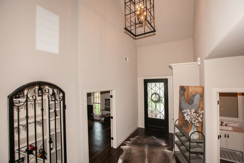 003_Entry With Wine Room.jpg