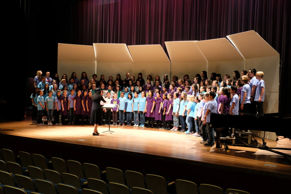 Judith Chan    rehearsing choristers for the afternoon session of the 2017 Children's Choral Festival at Holy Names University.