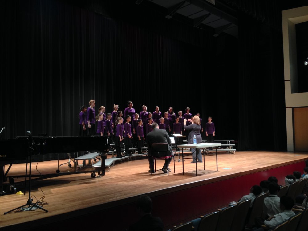Buddy James   , from CSUEB and clinician for the 2014 Children's Choral Festival, working with one of the afternoon choirs in a coaching session.