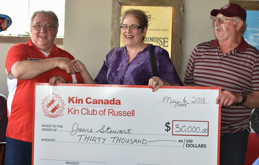 Catch the Ace chair Bill McInnis (left) presents Janice and Dave Stewart with a cheque for $30,000. The next Catch the Ace lottery starts June 17th.