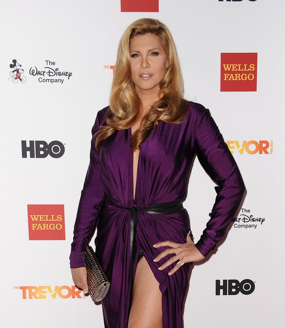 Candis Cayne - First transgender actress to hold a recurring role on primetime tv