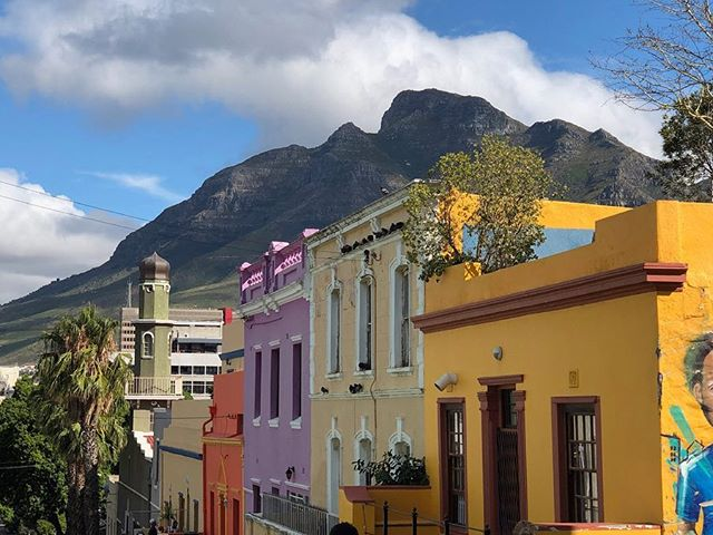 Bo-Kaap is a Cape Town neighborhood on the foothill of Signal Hill with an incredible history and culture. Since the 1760s, this has been a place where slaves from the East Indies and other parts of Africa resided in small white rental houses. It's even home to Cape Town's first mosque established in 1794. After slavery was abolished in the 1830s, to celebrate their freedom, the houses were colorfully painted and this neighborhood became a vibrant center to the Cape Malay community of tradesman and artisans. Today, this small neighborhood is becoming susceptible to gentrification and getting usurped by city development. If you know me, you know I don't like to shill, but if you're interested in visiting Cape Town I highly recommend reaching out to @sojourn.tours to help make it a meaningful experience! #capetown #southafrica #history #explore