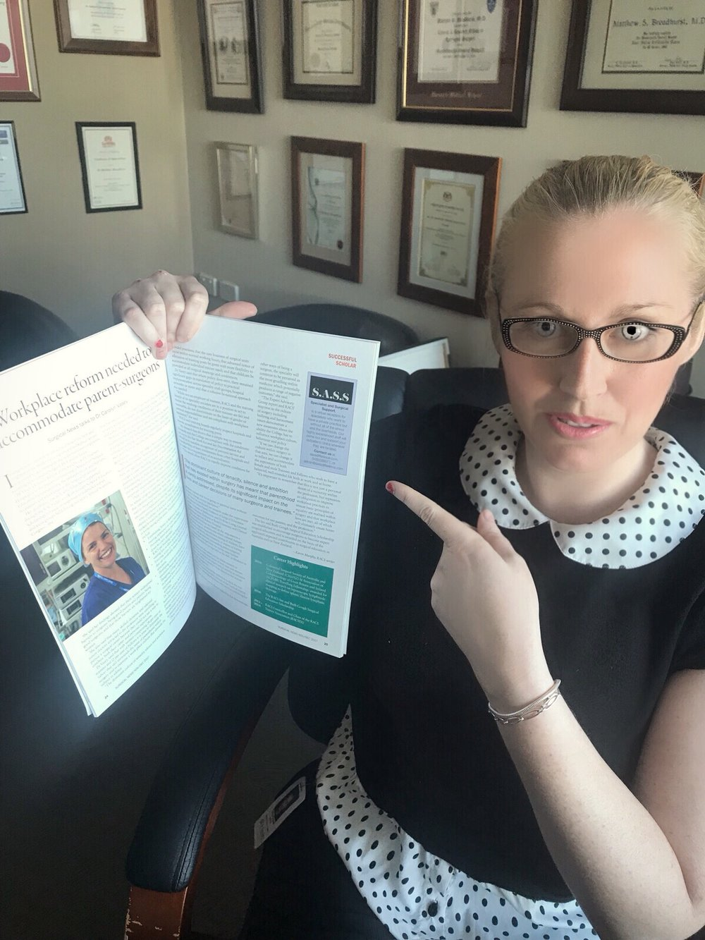 Director Tara Claire proudly showing the companies first advertisement in Surgical News Magazine