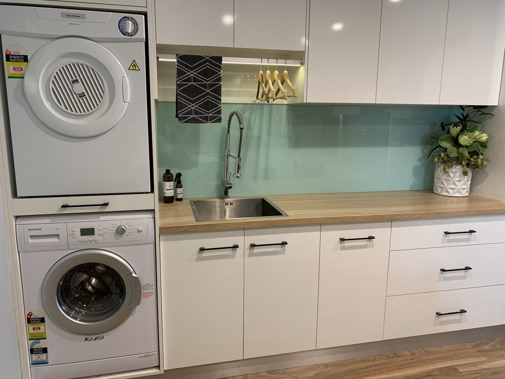 Laundry - Bench Top: Polytec Natural Oak RavineCupboards: Polytec Classic White SheenHandles: Furnware M3163.160MB