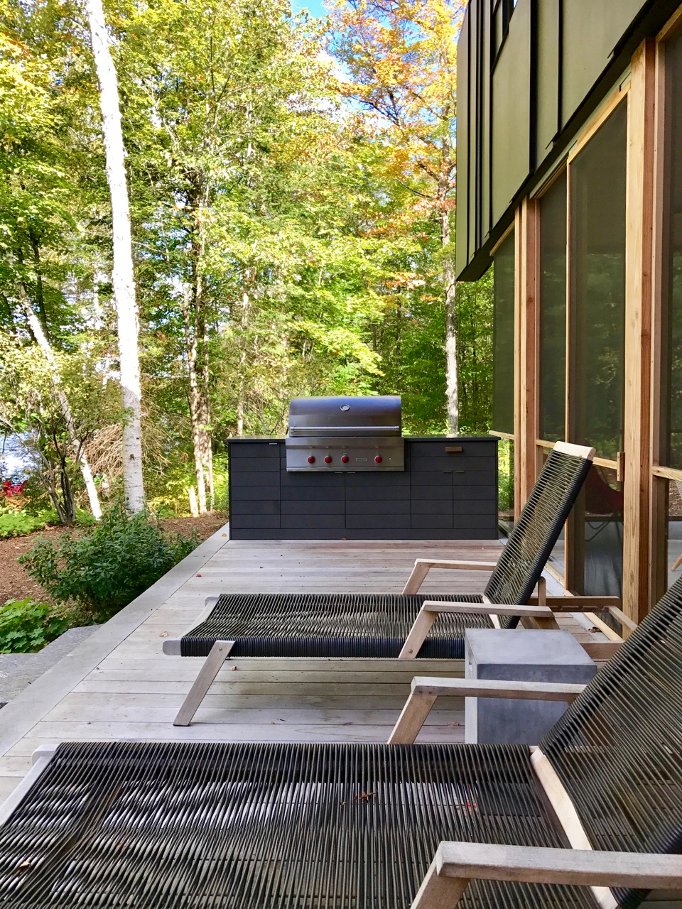 With top quality teak reclining loungers situated on our front deck, there's nowhere better to wait out the warm-up of a barbecue.
