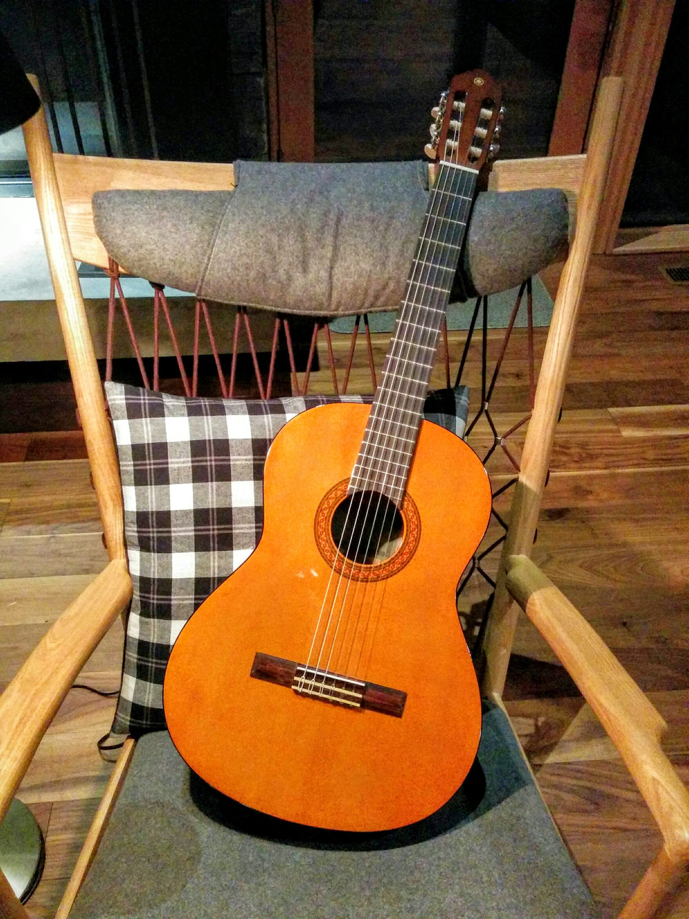 A Guitar Waits Patiently in the Great Room for the Evening's Guests to Arrive