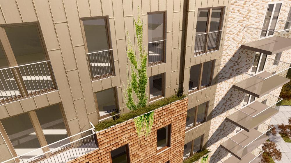 Fasaden är varierad i djup och material med inslag av grönska.