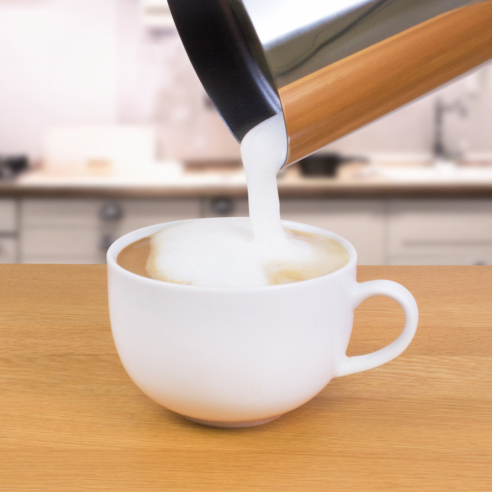 Pouring froth with a stainless steel milk frother