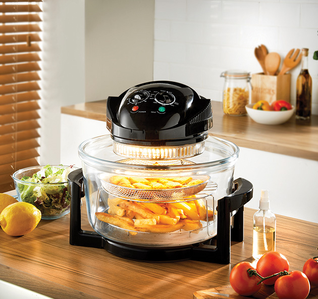 Multifunction Air Fryer Oven on the kitchen table cooking fries