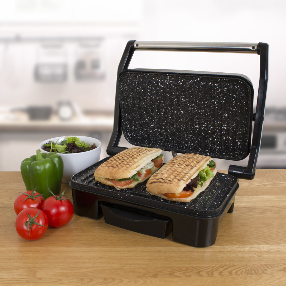 Deluxe Health Grill on the kitchen table grilling paninis