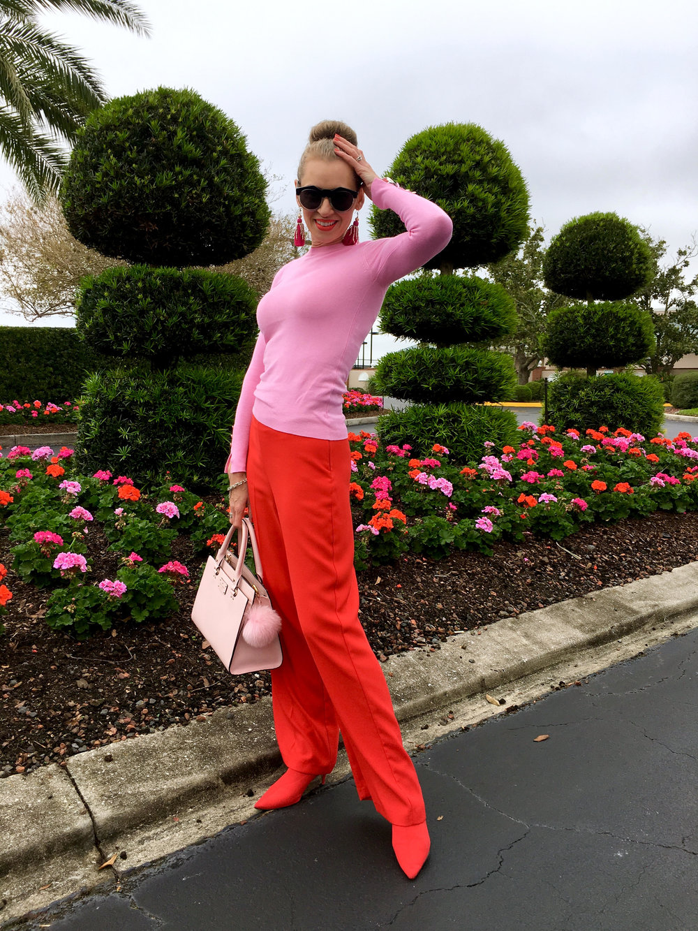 Apeing the topiary in River Island trousers with Zara sweater and boots and Kate Spade purse, Tara Golf and Country Club