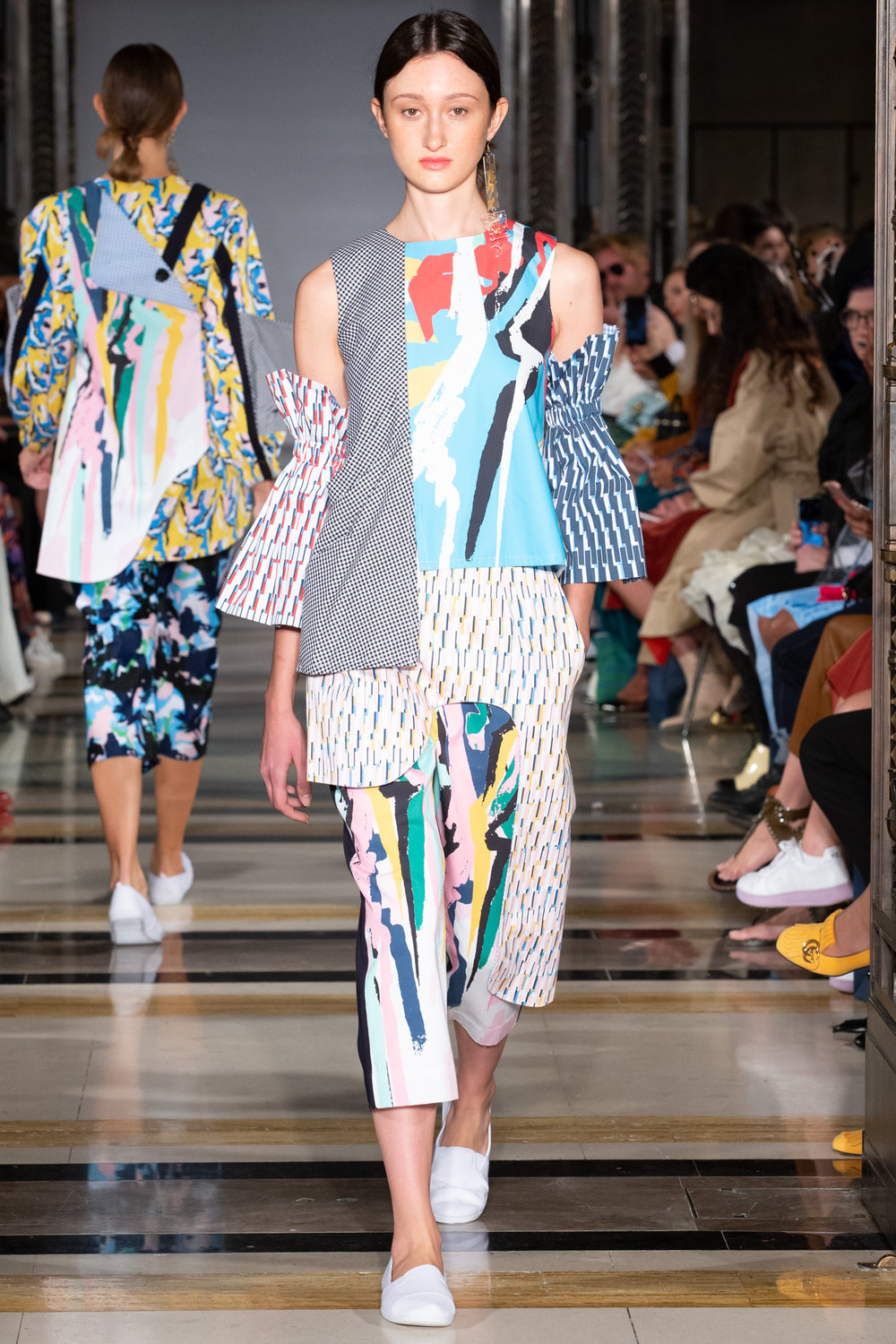 cassey gan - Graffiti prints in every shade, from sky blue and jade green to powder pink and yellow, were splashed with bold black strokes that recalled an almost-forgotten, 80s, graffiti aesthetic of my childhood t-shirts and dance-wear.Overlapping layers and elements of deconstructed shirting created a collection that screamed comfort, clashing patterns and colour - bring on those lazy, hazy, crazy days of summer!Photo credit: Simon Armstrong