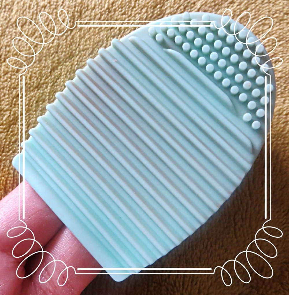 egg wash - This nifty tool has made cleaning my makeup brushes a doddle! It fits on two fingers and lets you clean without getting your hands wet, soapy or hot, saving my already dry hands. Add a bit of shampoo (or whatever soapy cleanser you want) onto the silicone pad, wet your dirty makeup brush and use the ridges to foam up and agitate the makeup off the bristles. Once you have disglodged the makeup, run the brush and the pad under the tap, again using the ridges to help rinse the dirt away. This method also minimises the amount of water and detergent trickling into the ferrule and potentially loosening the glue that holds the bristles in place. You cannot go wrong with this handy tool, I got my BrushEgg for a pound on Amazon!