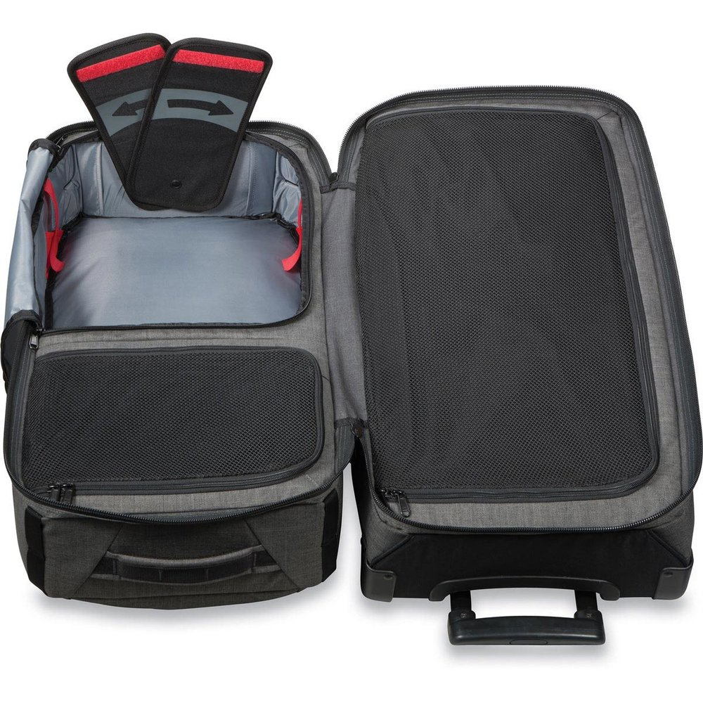 The two wing flaps in this luggage provide support when folded down into the corners, but swing upwards so the suitcase top can be reduced to pretty much just fabric.