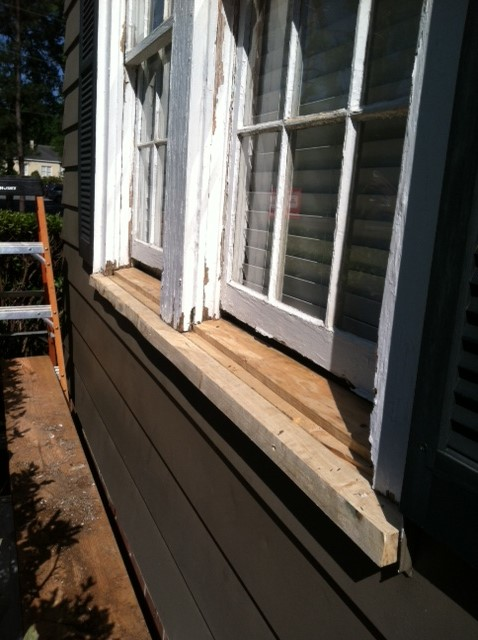 Replacing a rotten sill before installing a new window is an important step in quality workmanship.