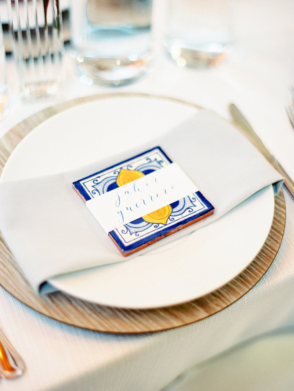 Wedding place setting with Spanish tile and calligraphy placecard