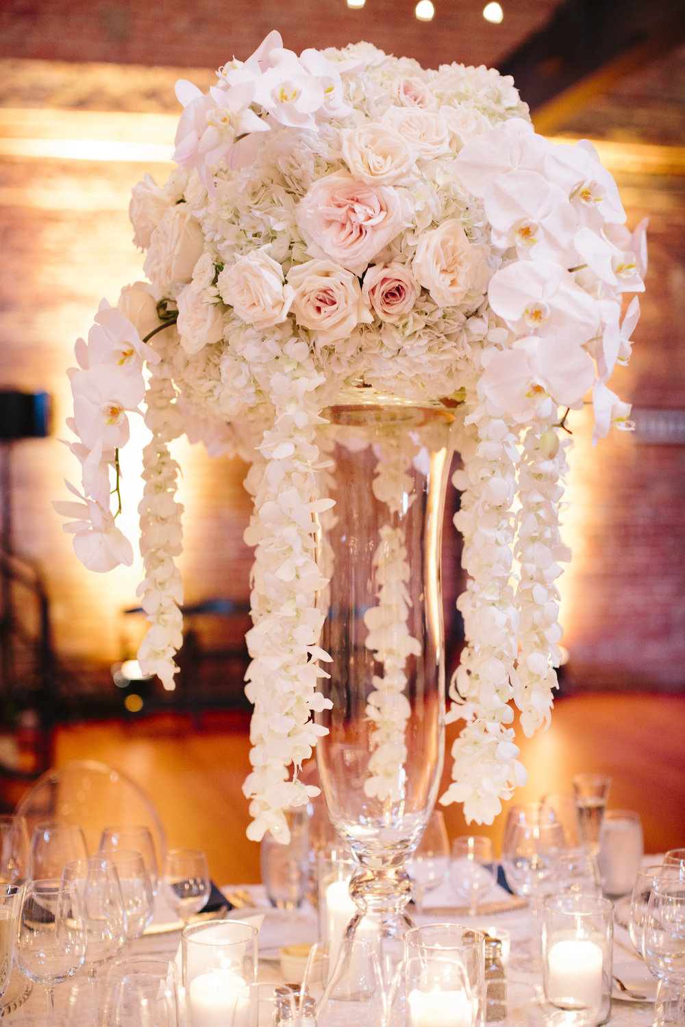 Pink and white rose cascade wedding centerpiece