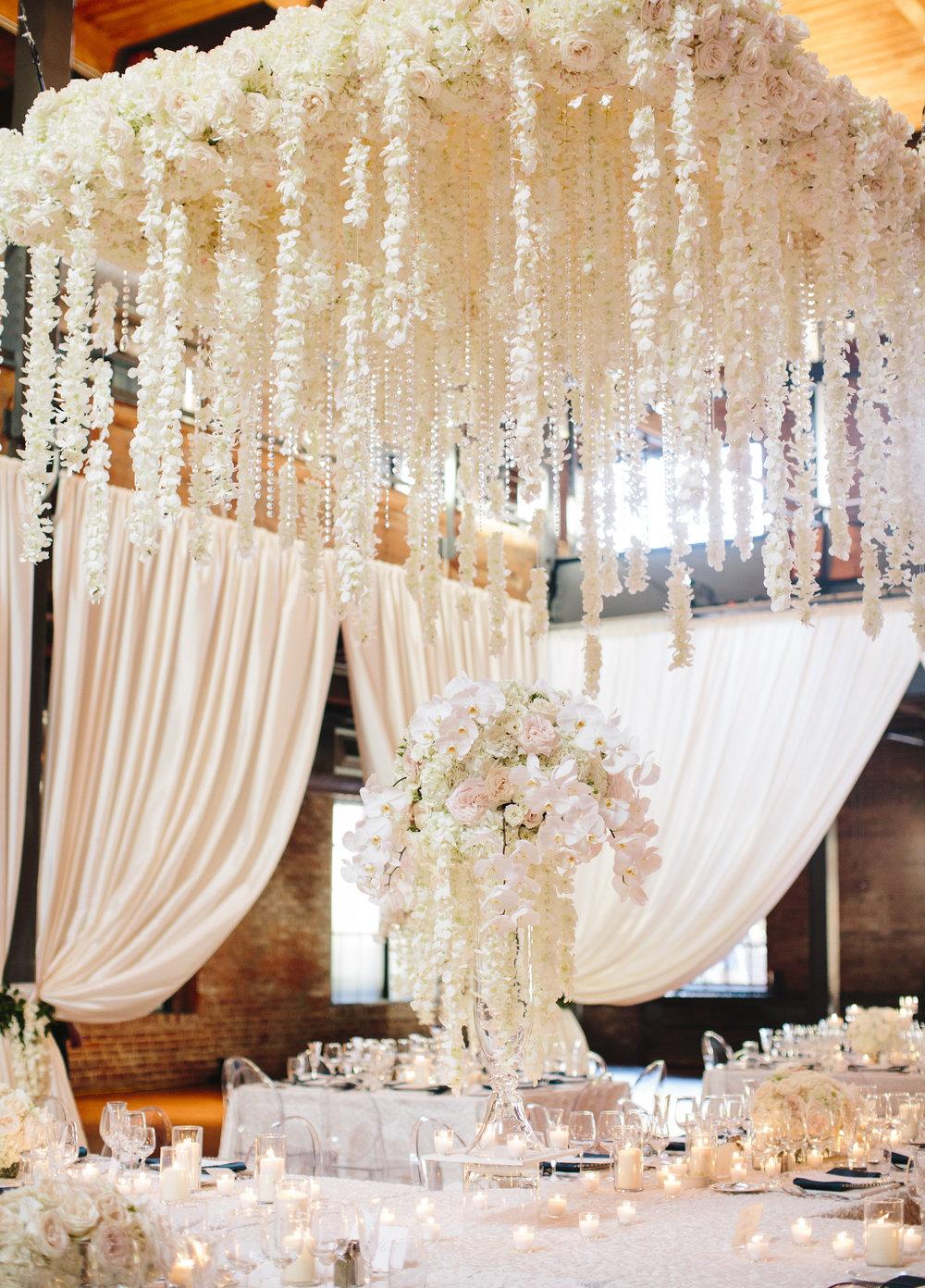 Stunning white floral cascade overhang over head table